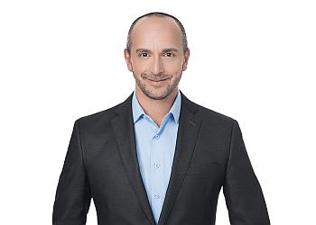 Saguenay immigration lawyer Robert-André Adam