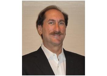 Whitby podiatrist Robert Chelin DPM, FAAAFAS, DAAPM, FFPM RCPS (Glas)