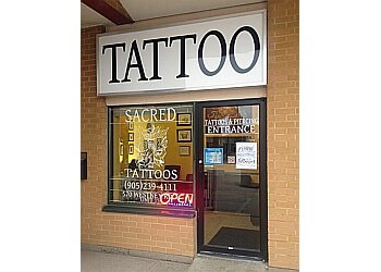 Ajax tattoo shop Sacred Tattoos