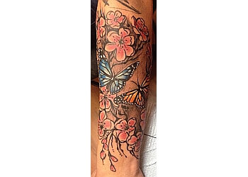3 best tattoo shops in georgetown on threebestrated for Georgetown tattoo shops